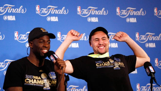Golden State Warriors forward Draymond Green (left) and guard Klay Thompson (right) at a press conference after game five of the 2017 NBA Finals against the Cleveland Cavaliers at Oracle Arena.