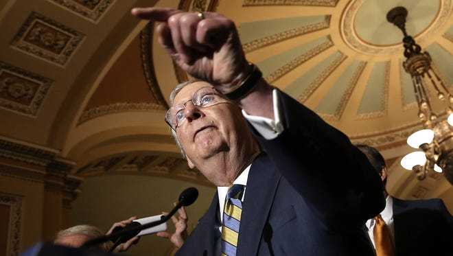 Senate Majority Leader Mitch McConnell, R-Ky., answers questions at the U.S. Capitol.