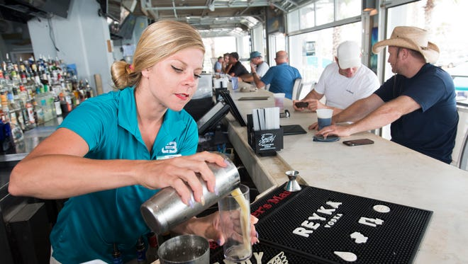 Bartender, Susan Dickson, at the Casino Beach Bar and Grille is preparing to work longer hours than usual as the beach business gears up of the Fourth of July holiday weekend.