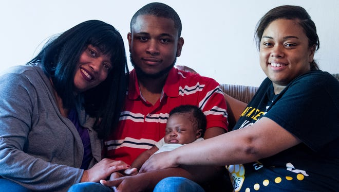 Meleke Burton, center, his mother Stacey Hughley, left, his sister Laconyal Hughley and his niece Gabrielle McCurdy are shown at their home in Auburn, Ala. on Thursday April 19, 2018. Burton and his mother received help from Youth Villages in dealing with their family issues.