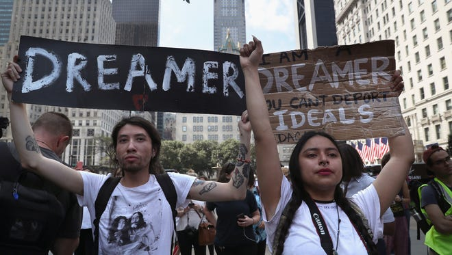 """Dreamers"" Jovan Rodrigo, 27, and Gloria Mendoza, 26, take part in a protest near Trump Tower on Sept. 5, 2017 in New York City."