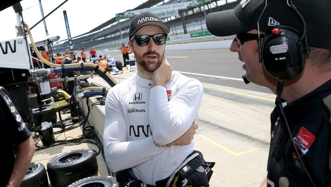 Schmidt Peterson MotorsportÕs James Hinchcliffe (5) talks to his crew before practice for the Angie's List Grand Prix of Indianapolis Thursday, May 7, afternoon at the Indianapolis Motor Speedway.