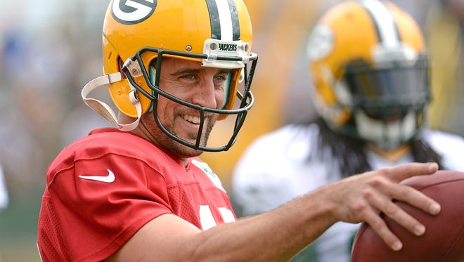 Quarterback Aaron Rodgers grins during Green Bay Packers Training Camp at Ray Nitschke Field Aug. 26.