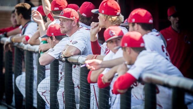 Ball State's Caleb Stayton joins teammates in the dugout during their game against Eastern Michigan at Ball State on Friday, May 6, 2016.