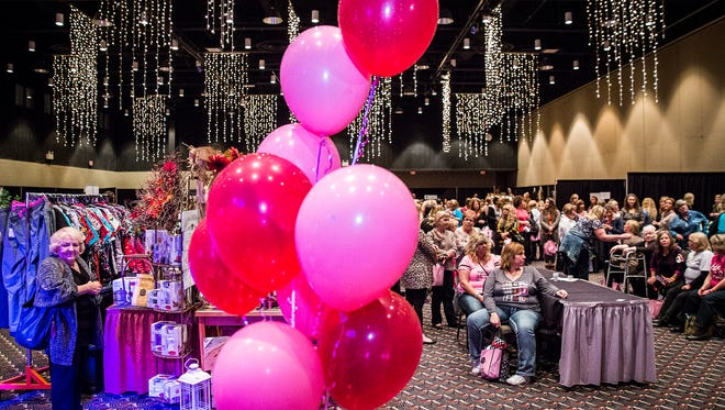 Hundreds attended the Wine, Dine and Unwind event at the Horizon Convention Center Thursday evening.