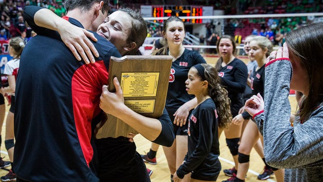 Coach Jared Richardson congratulates Chase Curry for her mental attitude award at Worthen Arena Saturday.