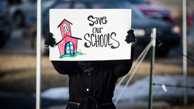"Hundreds of teachers, students and community members gathered Feb. 10 for the ""Save MCS"" rally at McGalliard Road and Wheeling Avenue."