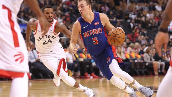 Pistons guard Luke Kennard (5) drives to the basket against Raptors guard Norman Powell during the Pistons' 116-94 exhibition loss on Tuesday, Oct. 10, 2017, in Toronto.