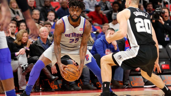 Pistons forward Reggie Bullock (25) gets defended by Spurs guard Manu Ginobili (20) during the second quarter on Saturday, Dec. 30, 2017, at Little Caesars Arena.