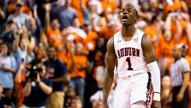 Auburn Tigers guard Jared Harper (1) celebrates after hitting a 3-pointer during the NCAA basketball game on Wednesday, Feb. 21, 2018, in Auburn, Ala.
