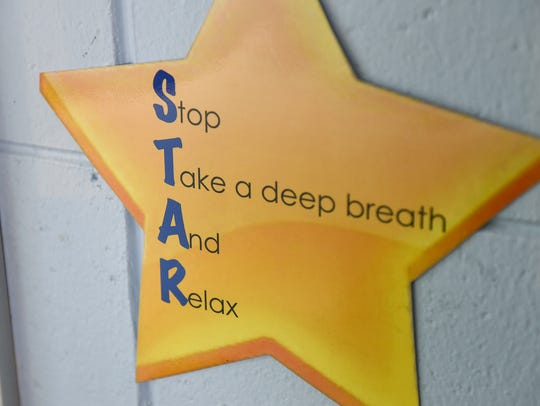 A sign outlines mindfulness steps Thursday, Jan. 26,
