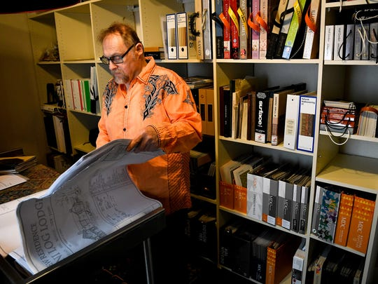 Michael Uvanni looks at some plans at his interior