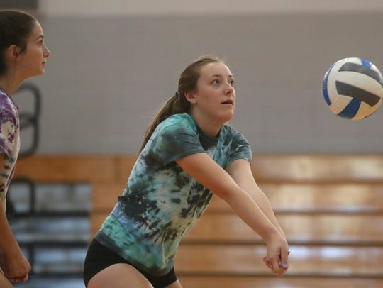 Foothill High School sophomore Sara Ault returns a