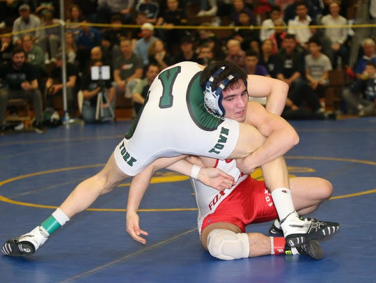 Fox Lane's Matt Grippi defeats Yorktown's Conner Thomas