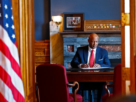 Indiana Attorney General Curtis Hill goes to work at his Statehouse office in Indianapolis, after he made a statement, Monday, July 9, 2018, about allegations of sexual harassment made by four women. Hill is accused of inappropriately touching four women in a bar in March 2018.
