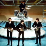 "The Beatles perform on the CBS ""Ed Sullivan Show"" in New York in this Feb. 9, 1964 photo. Ringo Starr plays drums and playing guitars from left are Paul McCartney, George Harrison and John Lennon. An estimated 73 million Americans tuned in, the largest ever for a TV show at the time, or three times the amount of people who watched the latest 'American Idol' finale, according to the Nielsen Co."