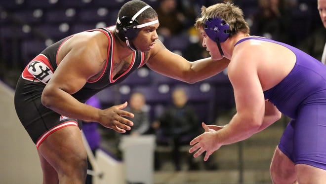 St. Cloud State's Lawrence Phillips (left) wrestles during the regular season in the 285-pound weight class. He will be one of 10 Huskies trying to qualify for the NCAA Division II tournament during this weekend's Super 3 Regional at Halenbeck Hall.