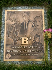 The gravestone of Brandon Wingo rests at Gracelawn Cemetery in an area called Garden of Serenity just 80 steps away from the grave of Jordan Ellerbe, a teen believed to be associated with a rival gang in Wilmington.