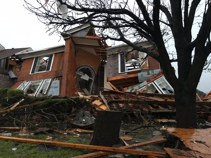 Damage of a house is seen after Saturday's tornado