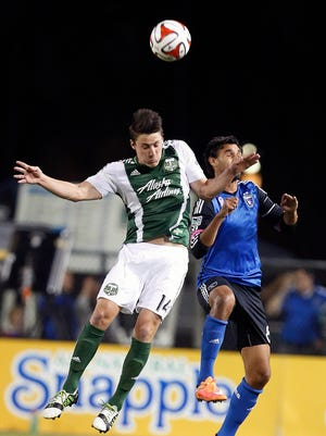 Portland Timbers midfielder Ben Zemanski, left, goes for a header against San Jose Earthquakes forward Chris Wondolowski, right, during the first half of an MLS soccer game in Santa Clara, Calif. The emphasis for the Portland Timbers in the offseason was on shoring up the defense.The team, which was known for its defense in its first season under Caleb Porter in 2013, struggled last season, allowing 52 goals, Friday, March 6, 2015.