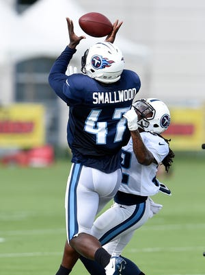 Titans linebacker Yawin Smallwood (47) breaks up a pass intended for running back Dexter McCluster (22) during practice at St. Thomas Sports Park Tuesday Aug. 18, 2015, in Nashville, Tenn.