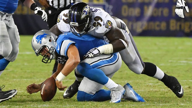 Lions quarterback Matthew Stafford is on the ground and is starting to get up when the Ravens' Timmy Jernigan comes in for a late hit late in the second quarter.