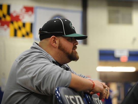 Parkside football coach Brendan Riley watches Jose Vasquez-Ramos battle at the Bayside wrestling championships.