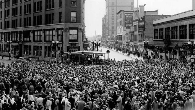 Crowds gather downtown Rochester after the surrender of Germany during World War II. (Staff photo, 1945)