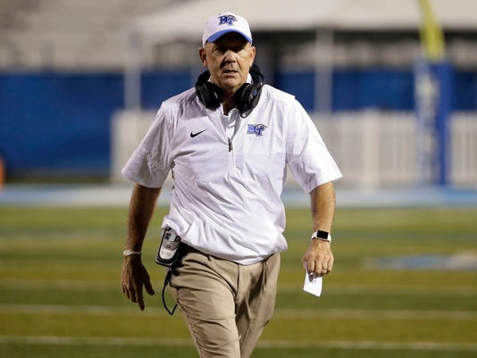 FILE -- In this Sept. 3, 2016, file photo, Middle Tennessee head coach Rick Stockstill walks on the field during an NCAA college football game against Alabama A&M in Murfreesboro, Tenn. Stockstill hopes his son, quarterback Brent Stockstill, can stay healthy after missing three games last season with a broken collarbone. (AP Photo/Mark Humphrey, File)