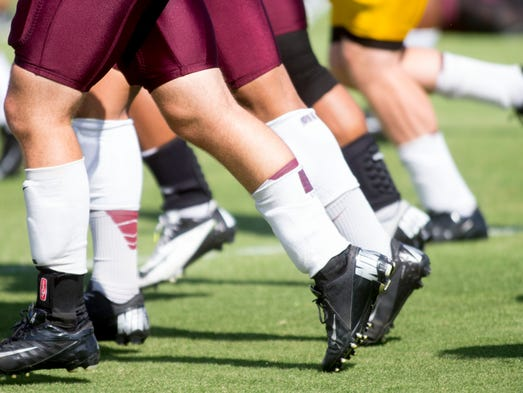 ASU players run on the field during football practice at Kajikawa Practice Fields in Tempe on August 8, 2014.