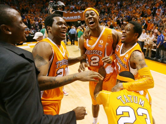 Tennessee's Emmanuel Negedu, Kenny Hall, Scotty Hopson, Bobby Maze and Cameron Tatum, left to right, celebrate after defeating Kentucky 74-65 at Thompson-Boling Arena Saturday, Feb. 27, 2010.