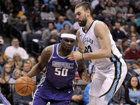 Sacramento Kings forward Zach Randolph drives against Memphis Grizzlies center Marc Gasol in a game last season. The Kings and Grizzlies play Wednesday.