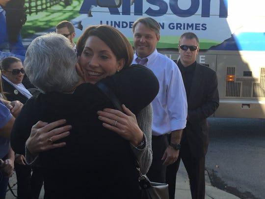 Grimes hugs Candace Witte of Covington.