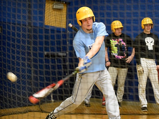 The Vikings' Seth Walmer connects on a pitch during indoor practice Monday, March 28, at Northern Lebanon High School.