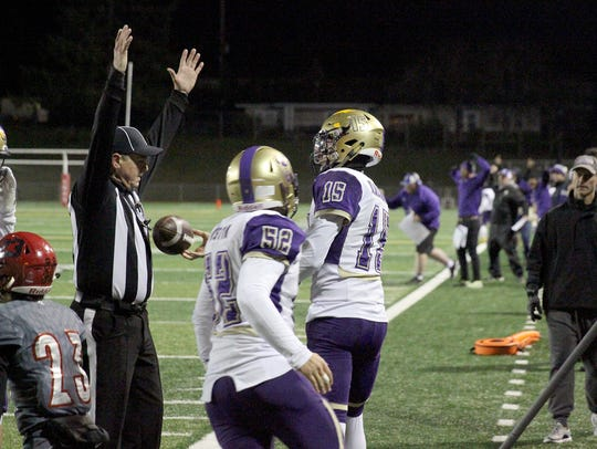 North Kitsap quarterback Andrew Blackmore hands the