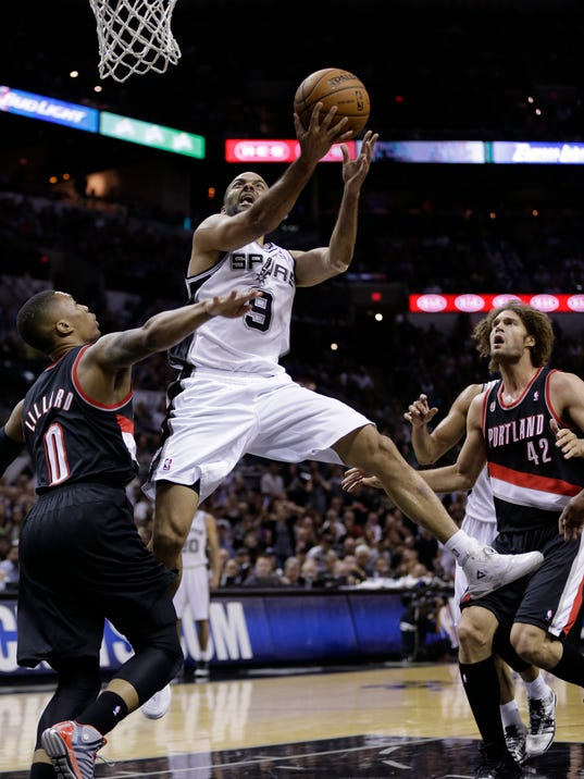 San Antonio Spurs' Tony Parker (9), of France, drives around Portland Trail Blazers' Damian Lillard (0) during the first half of Game 2 of a Western Conference semifinal NBA basketball playoff series, Thursday, May 8, 2014, in San Antonio.  (AP Photo/Eric Gay)
