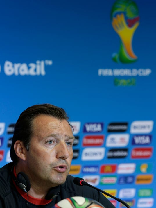 Belgium's head coach Marc Wilmots speaks during a press conference the day before the World Cup round of 16 soccer match between Belgium and USA at Arena Fonte Nova in Salvador, Brazil, Monday, June 30, 2014. (AP Photo/Julio Cortez)