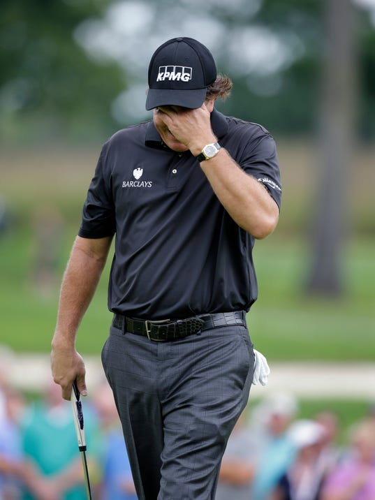 Phil Mickelson reacts after missing a putt on the 15th hole during the second round of play at The Barclays golf tournament Friday, Aug. 22, 2014, in Paramus, N.J. (AP Photo/Mel Evans)