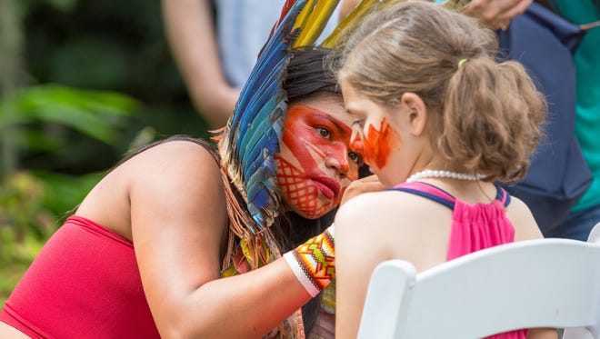 "Face-painting is part of ""A Journey to Mutum: A Cultural Encounter with the Yawanawa people of the Brazilian Amazon.""  The presentation, shown here at the Kampong Botanical Gardens in Coral Gables, Florida, earlier this year, is coming to Ojai."