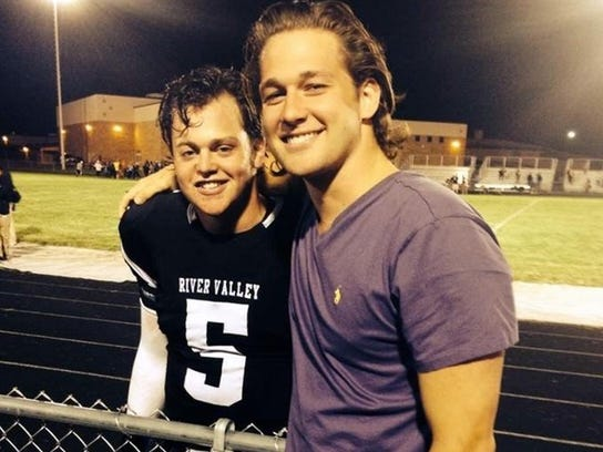 Beau Solomon (left) stands with his brother Cole outside