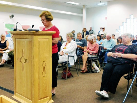 Frances Vasquez, chairwoman of the Democratic Party of Grant County, discusses the County Commission plan to add two new commissioners to the board during Thursday's public hearing. Randal Seyler - Sun-News