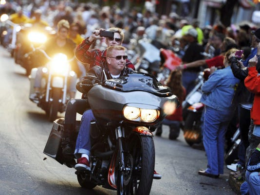 A biker shoots video as she rides the parade route during last year's York Bike Night.