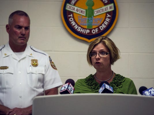 Jen Gettle, Dauphin County chief deputy district attorney, speaks to the media about 31 burglaries that occurred over the course of two month in two counties -- Dauphin and Cumberland -- and the arrest of five individuals involved. Patrick O'Rourke, Derry Township police chief, stands behind her.  Jeremy Long -- Lebanon Daily News