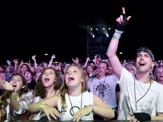 Fans sing along during Paramore's July 19 concert at Hersheypark Stadium.