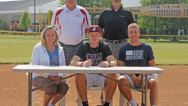 Coldwater's Austin Santure (center), joined by his family and head coach Randy Spangler, signed his letter of intent to play baseball at Jackson College.
