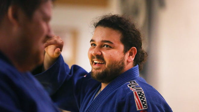 Rameen Almozaffar works out Tuesday, Nov. 14, 2017, in Appleton, Wis. Almozaffar qualified for the U.S. team in judo.