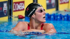 Missy Franklin (4) looks on after competing during