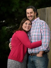 Jessica Ray with her husband Allen at their home in Gallatin.