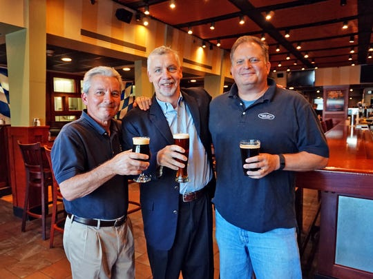 Iron Hill Brewery & Restaurant founders Kevin Davies, Kevin Finn and Mark Edelson (left to right) in Newark last month.