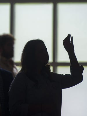 A congregant worships during a Sunday morning service at Redemption City Church in Franklin on June 4, 2017.